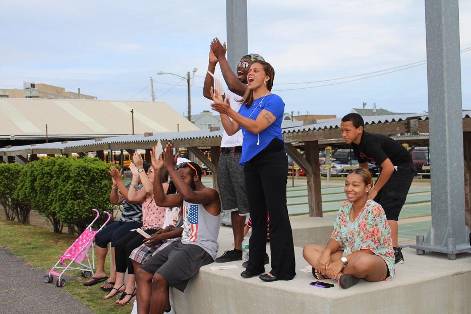 Relatives of graduates Garrett and Grace Jones cheer the announcement of their graduation