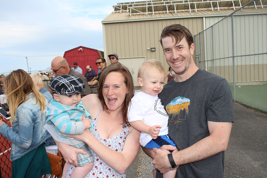 Megan Scherer holds Levon Bruce and John Steindel holds son Dylan. They were at Carey Stadium to celebrate the graduation of Ethan Douris.