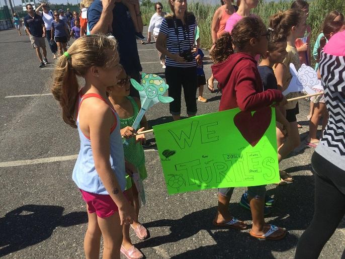 Children wait to help release the rescued Diamondback Terrapins.