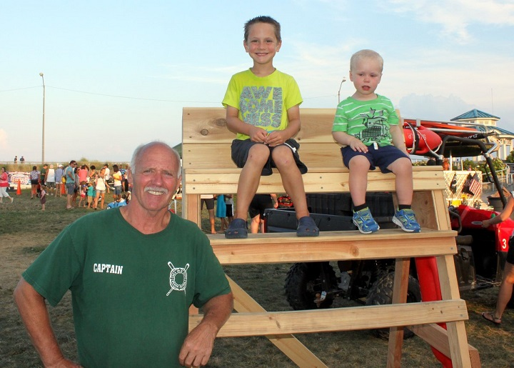 The Sea Isle City Beach Patrol and many other safety organizations will offer hands-on displays during Sea Isle's National Night Out celebration on August 2. Shown with youngsters during 2015's National Night Out is SICBP Captain Renny Steele.