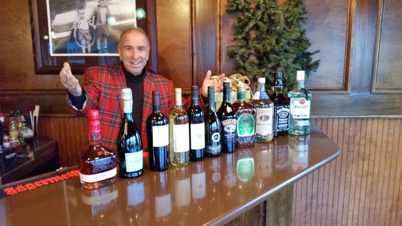 The mayor presents all 11 bottles of liquor, wine and sparkling wine included in his holiday list.