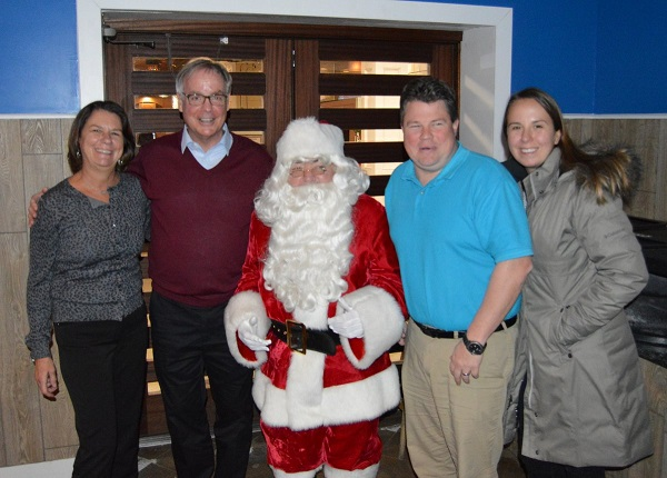 Santa Claus was on hand to thank everyone who participated in the Holiday Dash, including (from left) Debbie & Joe Brennan and Maureen & Bob Baldini, all of Sea Isle. Donations collected during the Holiday Dash benefitted Mayor Desiderio's Holiday Toy and Food Drive.