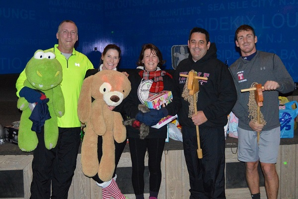 Tom ; Laura Barrett of Sea Isle City, Linda Matousch-Rau of Belleplain, and Don & Nick Matousch of Upper Township hold their toy donations following the Holiday Dash.
