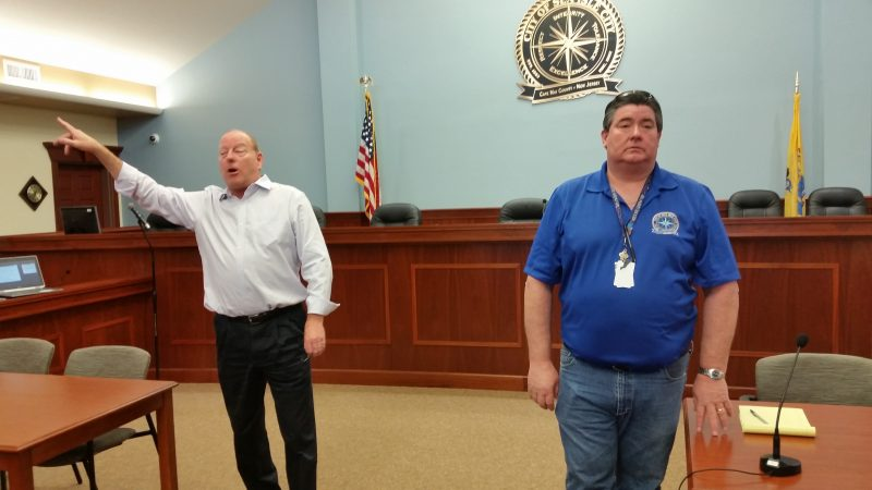 Consultant Jonathan Raser, left, and Sea Isle City Construction Official Neil Byrne explain the grant program during a community forum.