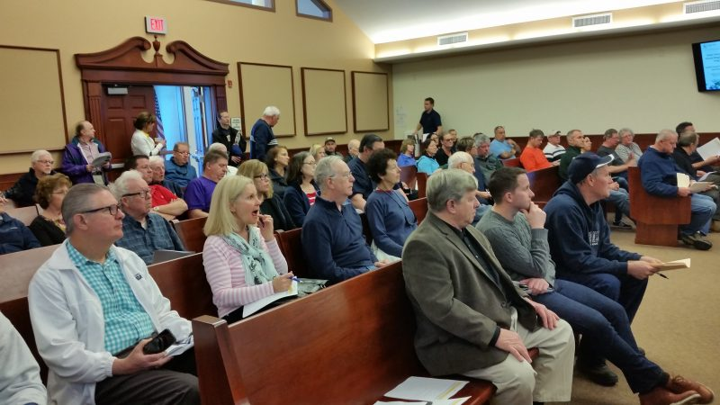 Residents from four Cape May County seashore towns listen to details about how to apply for grants to elevate their homes.