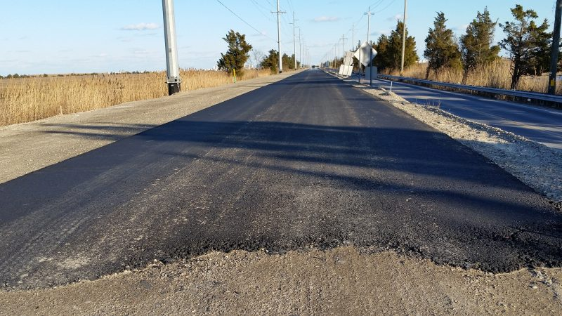 A fresh coat of asphalt was put down this week, giving a glimpse of what the new roadway will look like when it's finished this fall.